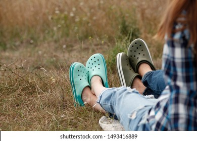 Man and woman wear flip-flops sandals while outdoors camping. Couple in Love Outdoors