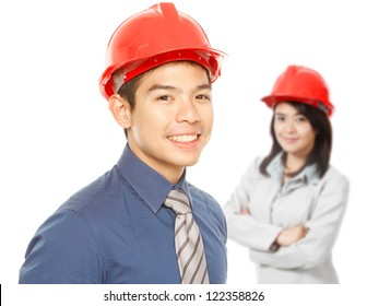 A man and woman wearing hardhats (on white)