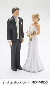 man & woman wedding cake topper