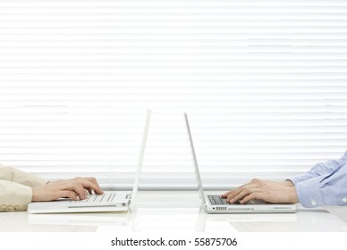 Man and woman who uses laptop computer
