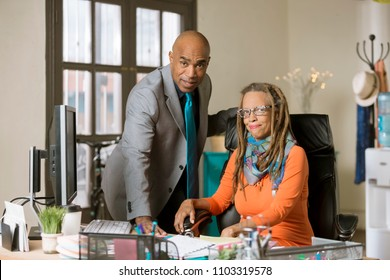 Man and woman working in a creative business office