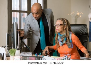 Man and woman working together in a creative business office