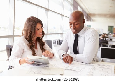 Man and woman working together in an architect?s office