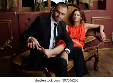 man and woman(girl/lady). man dressed in black suit. woman in dress. They love each other. love story. pre wedding shooting. Models in black, white and red. romance. relation. mirror . luxury