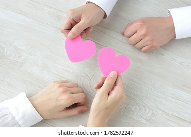 Man and woman's hands having heart object
