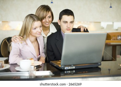 Man and Women at Cofe Table With Laptop. Short Depth of Focus (On Man's Face).