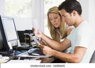 man and women at computer reading a letter