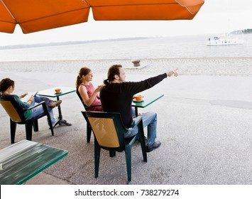 Man and women sitting at a cafe