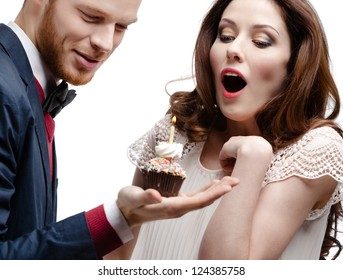 Man wonders his pretty girlfriend with birthday pie, isolated on white