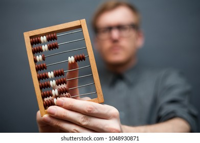 Man with wooden calculator