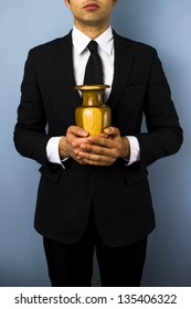 Man with wooden urn