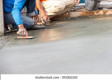 Man work Floor plaster cement