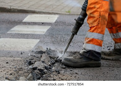 Man work with  knock hammer for repairing the road, selective focus