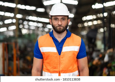 Man at work. Mechanical Engineer  man in Hard Hat Wearing Safety Jacketworking in Heavy Industry Manufacturing Facility. Professional Engineer Operating lathe Machinery