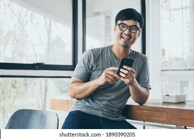 man work using cell phone hand holding mobile texting message contact us.chatting,search internet information in office.technology device communication connecting