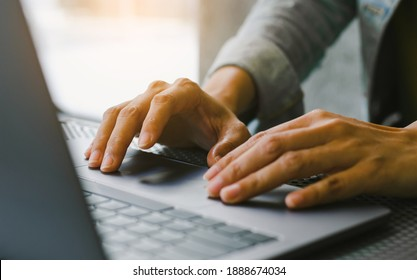 man work using computer hand typing laptop keyboard contact us online chatting search form internet sitting at office.concept for technology device communication business