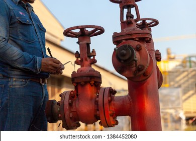 Man work valve fire hydrant. Construction engineer, Standard construction safety and construction site. Safety equipment for people working in industrial.
