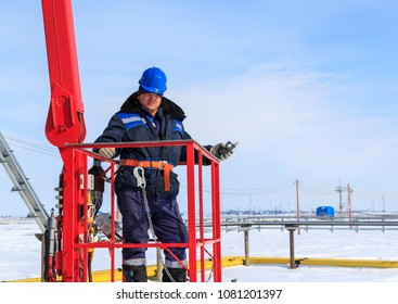 Man worker in a boom lift, machine control on the aerial platform.