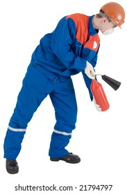 Man in worker to cloth and helmet with fire-extinguisher in hands