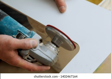 Man worker cutting beige tile with a saw on a cutting flooring tile