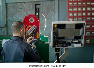 Man worker electrician works with energy panel and machinery equipment on plant