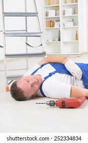 Man worker laying on a floor, concept of accident at work