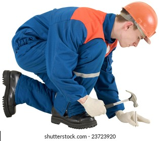 Man in worker overalls with hammer and nail