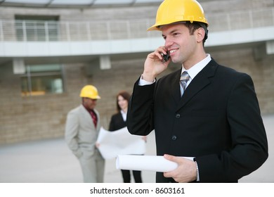 A man working as  architects on a construction site