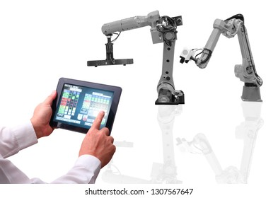 Man is working with automate wireless Robot arm in the automotive industry smart factory background