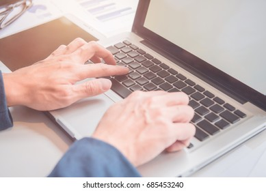 Man working bussiness in office with computer notebook and document data on table
