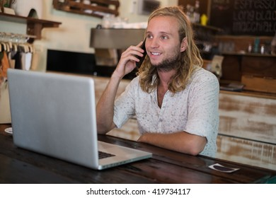 Man working in a cafe on a laptop