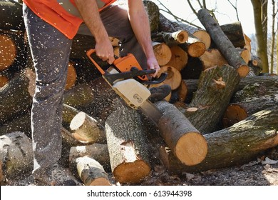Man working with chain saw