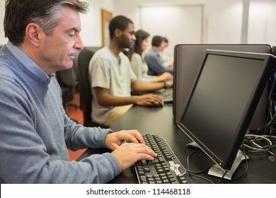 Man working at computer in computer class