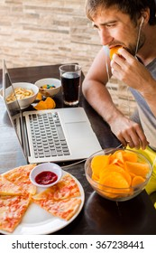 Man Working At The Computer And Eating Fast Food Unhealthy Lifestyle