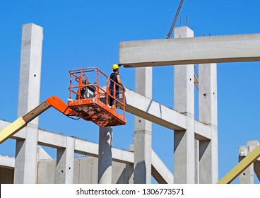 Man is working at the construction of a building