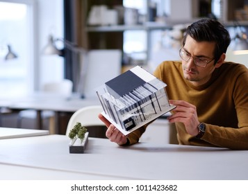 Man working in design and engineering architecture office