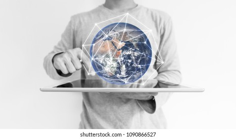a man working digital tablet and global network connection hologram technology. Element of this image are furnished by NASA
