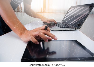 Man working with digital tablet, laptop and smart phone at his office.