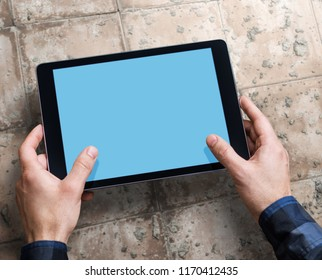 Man working with a digital tablet PC. Above view. Clipping path