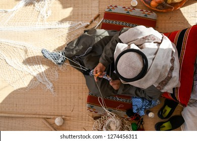 Man working handicraft from Saudi Arabia.