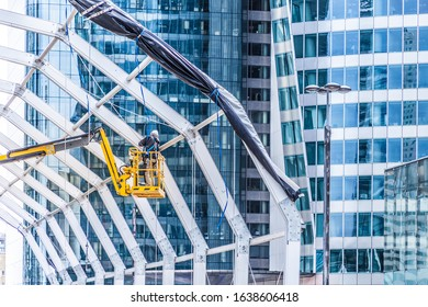 man working at height in the city