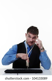 man working at his desk with a hangmans noose around his neck