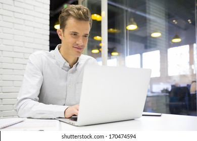 Man working at his laptop in the office