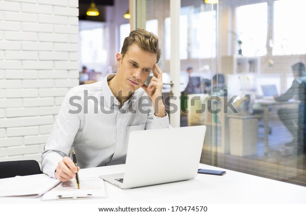 Man working at his laptop on the office in start-up