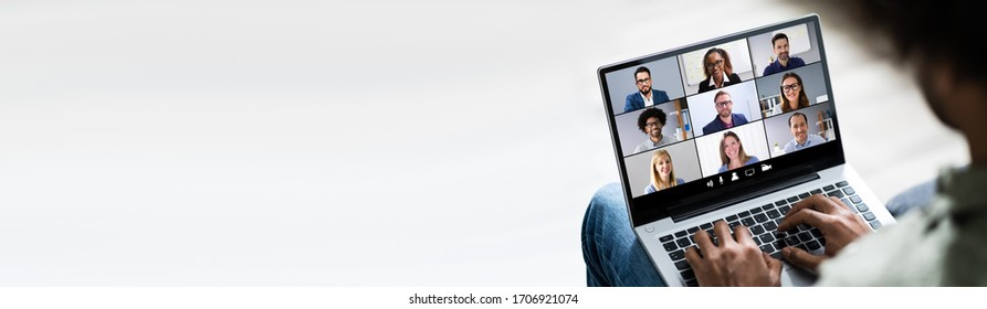 Man Working From Home Having Online Group Videoconference On Laptop - Shutterstock ID 1706921074