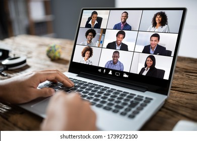 Man Working From Home Having Online Group Videoconference On Laptop - Shutterstock ID 1739272100