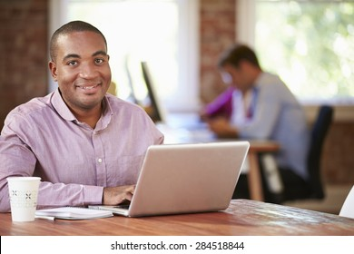 Man Working At Laptop In Contemporary Office