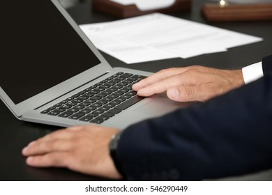 Man working with laptop in modern office