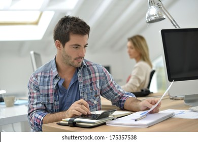 Man working in office in front of desktop