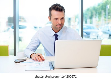 Man working at the office on laptop
